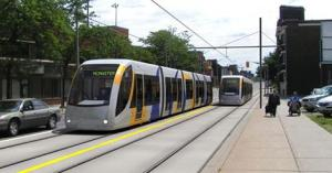 A rendering of the new LRT vehicles traveling through the city on dedicated rights-of-way